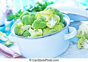 raw broccoli in bowl and on a table