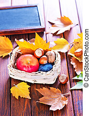 autumn background, autumn apples and leaves on a table