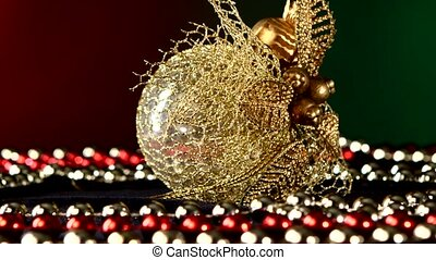 Shiny unusual gold toy for Christmas or New Year and beads,...