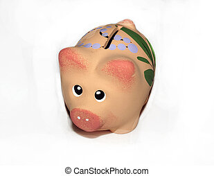 moneybox - piggy bank as a pig made from clay on a white...