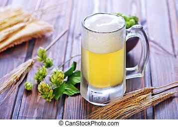 Beer - beer in glass and on the wooden table