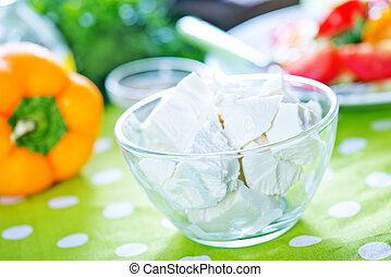 feta cheese with spice in the glass bowl