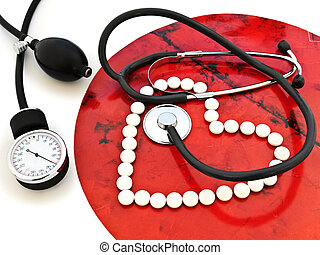health - stethoscope and a white pills heart