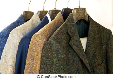 Assorted mens jackets on hangers - Assorted mens jackets in...