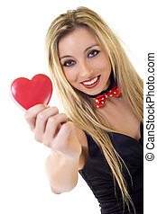 Woman holding Valentines Day heart sign with copy space