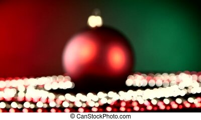 Shiny red toy for Christmas or New Year and beads, rotation,...