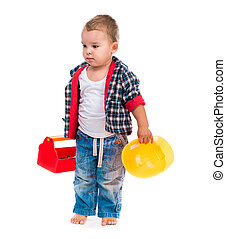 little boy with toy tools and helmet