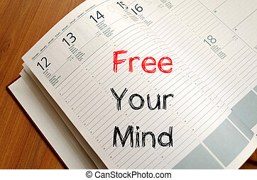 Free your mind write on notebook - Free your mind text...