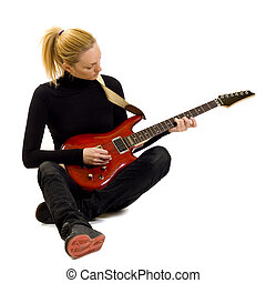 girl playing an electric guitar sitting down - passionate...