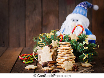 Christmas cookies and tinsel on a dark wooden background