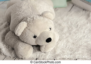 white soft toy bear in a childrens room