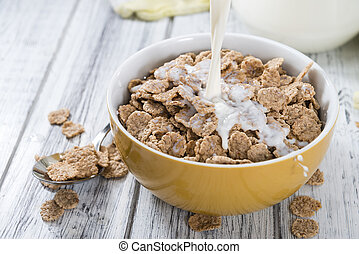 Pouring Milk in a bowl with Cornflakes - Pouring Milk in a...