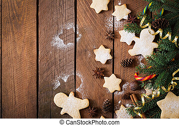 Christmas cookies and tinsel on a dark wooden background....