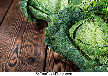 Savoy Cabbage close-up shot on wooden background