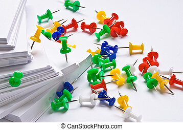 Office stationery - Colorful push pins and paper isolated on...
