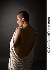 Back view of defenseless woman with shaved head - Rear view...