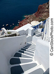 Beautiful grey and white steps and Aegean sea in Oia,...