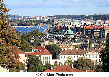 Prague Old Town with red roofs and Vltava river, Czech...