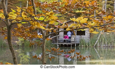 Family resting in a fishing lodge - Family resting in a...