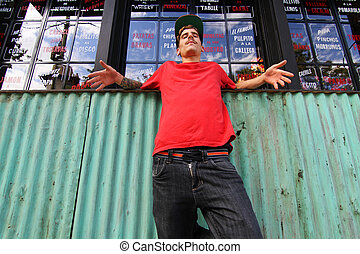 Breakdancer waiting - A cool hip-hop dancer chilling in the...