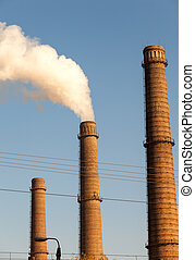 Chimney smoke with blue sky The global