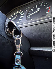 Ignition Key - Ignition key inside of a car in a low angle...
