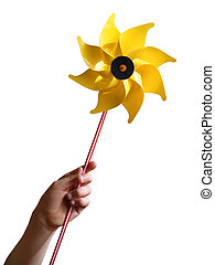 Yellow Windmill - Children\'s hand holding a yellow toy...