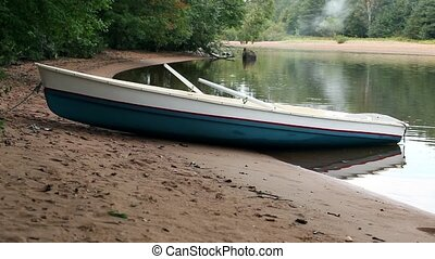 rowing boat on the beach close to - beautiful landscape with...