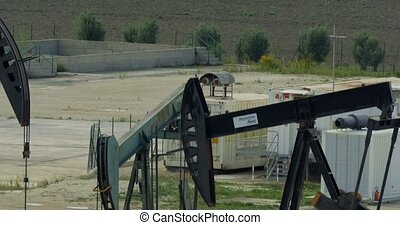 4K, 3 Oilpumps in Sicily, Italy - Oilpumps, Oilfield. Graded...