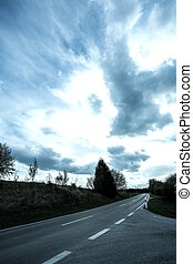 Road under a dramatic Sky