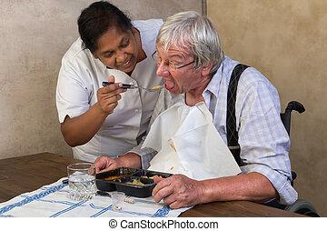 Nurse helping elderly man - Nurse in old people's home...