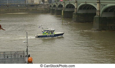 Police Speed Boat on River - A Police speed boat surfing the...