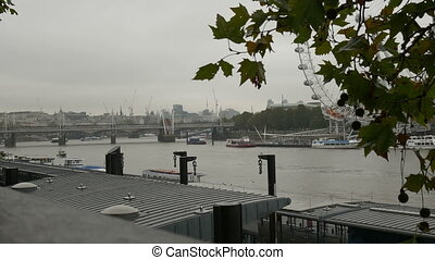 Banks of Thames on Cloudy Day - Ships and boats moored at...