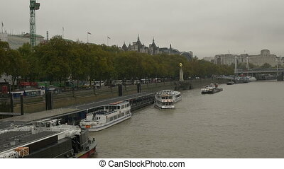 Banks of Thames in Coludy Day - Ships and boats moored at...
