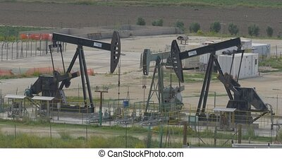 4K, 2 Oilpumps in Sicily, Italy - Oilpumps, Oilfield. Native...