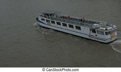 Tourists Boat on Thames River - Large touristic boat on the...