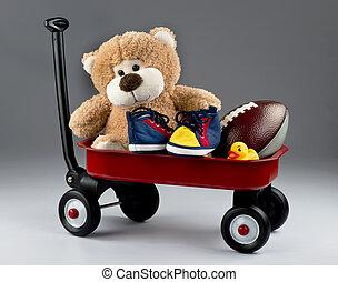 Cart full of toys. - Red wagon full of kids favorite toys.
