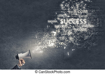 Megaphone in hand - Businessman hand with loudspeaker and...