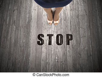 Stop right here - Top view of businesswoman feet and stop...