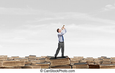 Businessman play pipe - Young carefree businessman on pile...