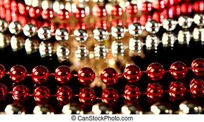 Unusual coral toy for Christmas or New Year and beads, rotation, on black, close up, dynamic change of focus