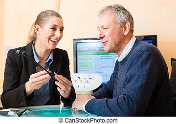 Deaf man makes a hearing test - Older man or pensioner with...