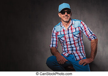 confident old casual man with baseball hat and sunglassed...