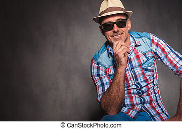 smiling senior casual man wearing sunglasses and summer hat...