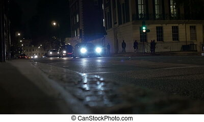 Night London Street Traffic - Vehicles on a street at...