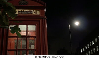 Night Phone Booth in London - A traditional red phone booth...