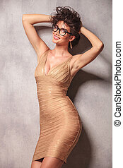 woman wearing glasses pose while holding her hair - sexy...