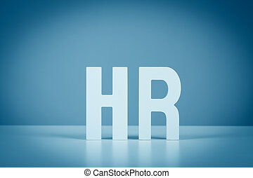 Human resources (HR). HR letters on table, blue toning.