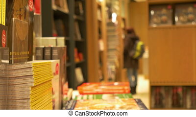 Inside a Bookstore - People inside a bookstore, illuminated...
