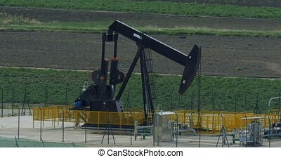 4K Oilpump in Sicily, Italy - Oilpumps, Oilfield. Graded...